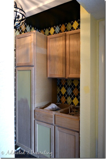 utility closet with cabinets 1