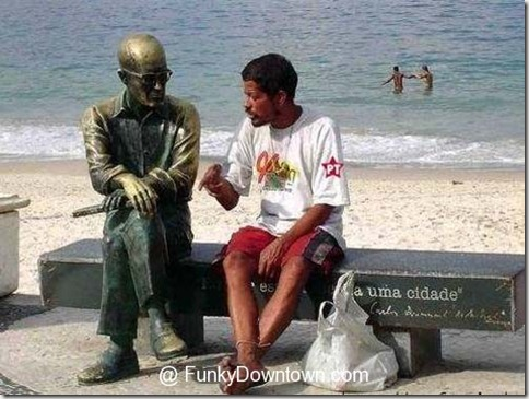 lonely-man-talks-statue