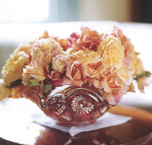 A turn-of-the-century carnival-glass fruit bowl holds a bouquet of pastel roses culled from Martha's garden, at once cradling the blossoms and letting them sprawl. (The Best of Martha Stewart Living -- Arranging Flowers)