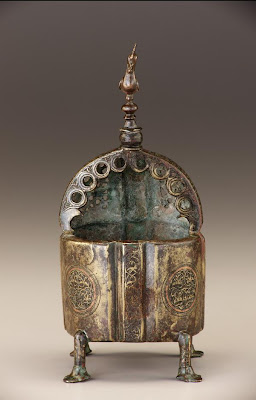 Incense burner | Origin:  Iran | Period: 12th century  Saljuq period | Details:  Not Available | Type: Brass, traces of copper inlay | Size: H: 22.8  W: 9.8  cm | Museum Code: F1977.5 | Photograph and description taken from Freer and the Sackler (Smithsonian) Museums.