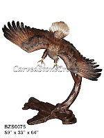 Bronze Eagle Swooping Right Over Branch