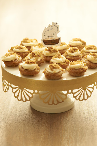 These bite-sized apple pie cupcakes from Baked by Melissa, www.bakedbymelissa.com, are a huge hit with kids and adults. Style them on a cake stand easily decorated with punched gold paper.