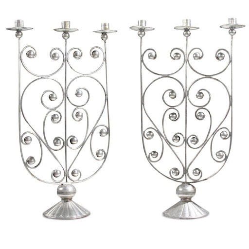 Ornate candlestick holders would make stunning centerpieces. (1stdibbs.com)