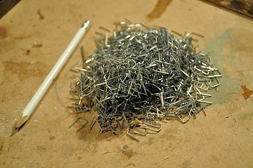 Yes, a big pile of staples. That's what was holding the canoe together while the glue was drying.
