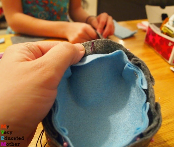 Sewing together origami inspired felt bowl