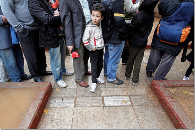 A child waits in line to receive food distributed from the Greek Orthodox Church in Athens, on Thursday, Dec. 22, 2011. The leader of Greece's Orthodox Church is promising to boost its campaign to provide free meals to the poor and homeless amid the country's deepening financial crisis.(AP Photo/Petros Giannakouris)