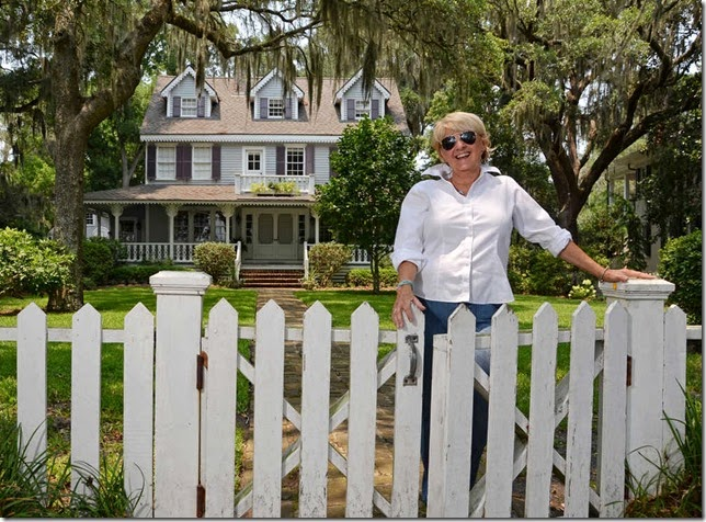 Interior designer/preservationist Jane Coslick stands in front of an Isle of Hope home on Bluff Drive that she renovated in the early 1980's. (John Carrington/Savannah Morning News)
