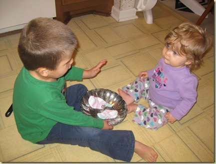 Ethan teaching Sienna how to use a steamer