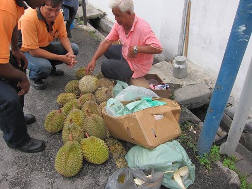 A streetside durian fruit vendor.