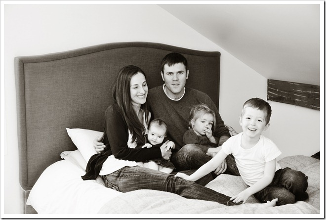 the family on the bed bw