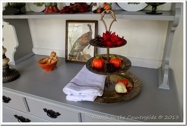 china cabinet decorated for Fall