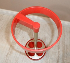 red plastic umbrella stand