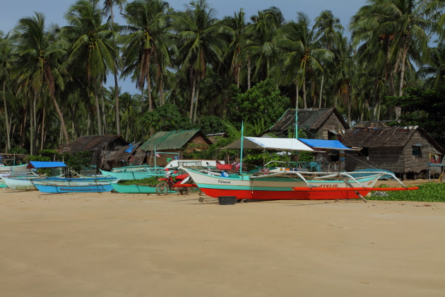 Fishermen huts on Nacpan Beach, Palawan, Philippines