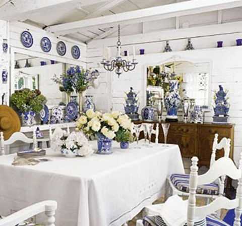 blue and white porcelain decorates a white dining room