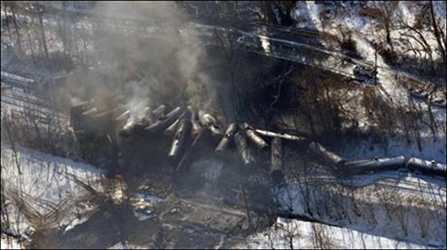 This aerial 17 February 2015 file photo photo made available by the Office of the Governor of West Virginia shows a derailed train in Mount Carbon, West Virginia. As investigators in West Virginia and Ontario pick through the wreckage from the latest pair of oil train derailments to result in massive fires, U.S. transportation officials predict many more catastrophic wrecks involving flammable fuels in coming years absent new regulations. Photo: Office of the Governor of West Virginia / Steven Wayne Rotsch / AP Photo