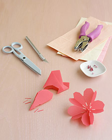 To Make, you'll need Glassine or Vellum papers in shades of pink and coral cut into 3 1/2 and 4 1/2 inch squares, scissors, a utility knife, and 1/4