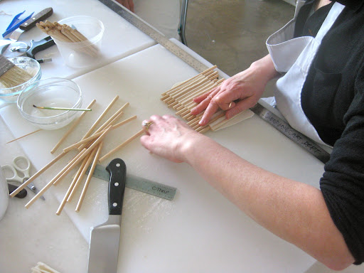 Step 2: Carefully and strategically remove the wooden sticks one by one.