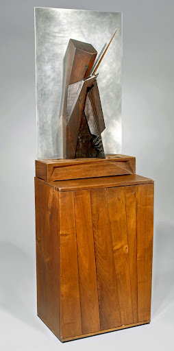 Moderne Gallery.  Wharton Esherick.  Pizzicato.  1931.  Rosewood sculpture on polished aluminum, sitting on sculpted oak light box and walnut music cabinet.  Provenance: Made for concertmaster of the Philadelphia Orchestra, Alexander Hilsburg.