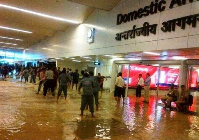 Indira Gandhi International Airport bore the brunt of a heavy monsoon downpour, which crippled services at the airport, 17 June 2013. The Palam area received 123.4 mm of rain during a 24 hour period. Photo: shukla_tarun / Twitter
