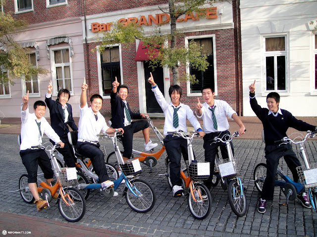 Japanese kids on bicycles at huis ten bosch in Sasebo, Nagasaki, Japan