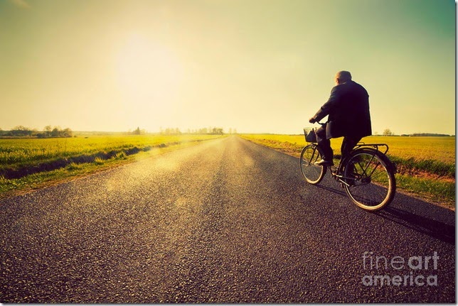 old-man-riding-a-bike-to-sunny-sunset-sky-michal-bednarek