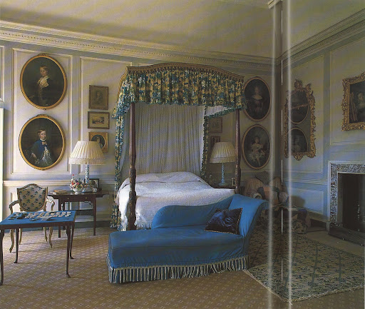 The Duchess' bedroom at Badminton. Her personality and presence can be felt in the design: a games table; a favorite chaise longue and a large arm chair with rugs thrown over it for the dog.