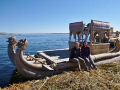 Posing with a reed boat on Lake Titicaca.