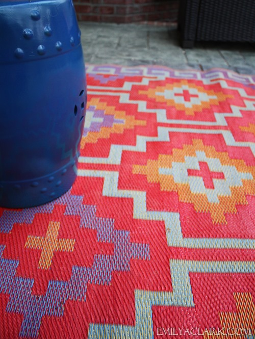colorful rug with ceramic garden stool