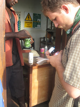 'A student inspects seeds with Alliance for a Green Revolution in Africa (AGRA), in Accra.' Photo by Sandra Vu