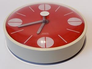 red Krups wall clock