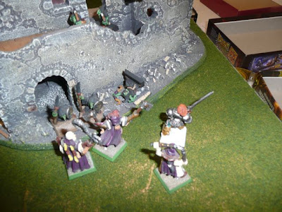 Sisters fight goblins outside ruined house