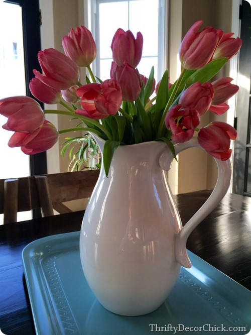 tulips in white pitcher