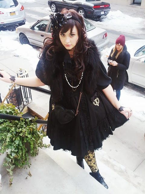 Miss Lumpy's full gothic lolita coordinate, with a BtSSB jumperskirt, vintage fur, and handmade accessories