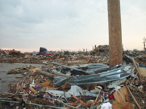The twisted metal and splintered wood debris of Joplin, Missouri. (Photo credit: Missy Belote)