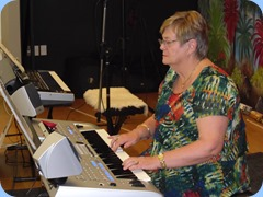 Our host, Barbara McNab, playing her Yamaha Tyros 4