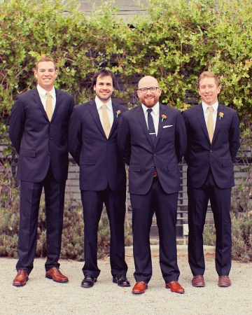 This groom picked out the navy J.Crew suits and khaki ties sported by the groomsmen.