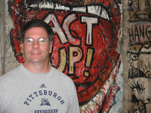 "Mark Rauterkus - before ""Act Up"" sign from The Berlin Wall"
