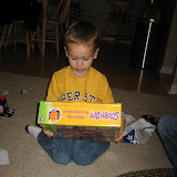 Sam opening his presents 11-3-11 (6).JPG