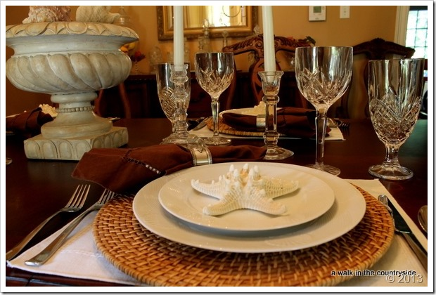 elegant table with brown, white & seashells