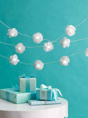 If you are looking for lighted decor, these Martha Stewart White Lighted Camellias are so crisp and sophisticated. (shop.marthastewart.com)