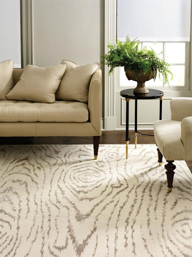 Faux animal prints bring instant fashion to a space, and they work as both a neutral canvas for furniture and also an identifiable pattern.