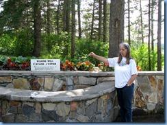 2269 Manitoba Riding Mountain National Park - Karen making a wish at Wishing Well