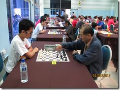 Syakir Syazmeer Azhar vs John Law, board 5, round 5.
