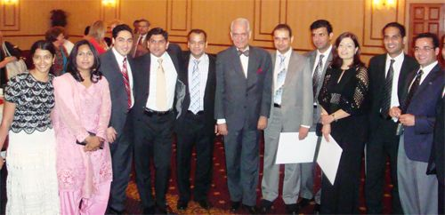 Dr. Qazi (center) with graduates at graduation party (2010)