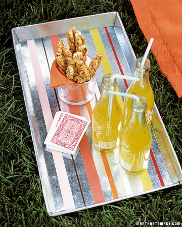Decorate a plain food tray for a customized addition to your summer picnic. (marthastewart.com/272222/stripes-tray)