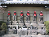 Outside a Fukagawa graveyard: Buddhas dressed up for Spring Equinox Day