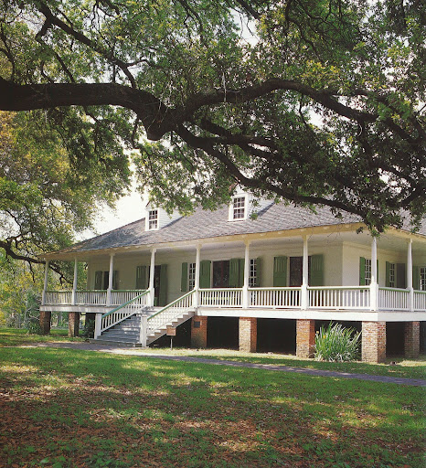 I love the wrap-around porch on the Magnolia Mound estate built in 1791.