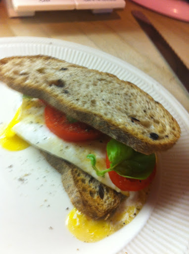 LQ Breakfast: toasted wheat, runny fried egg with melted mozz, tomato and basil