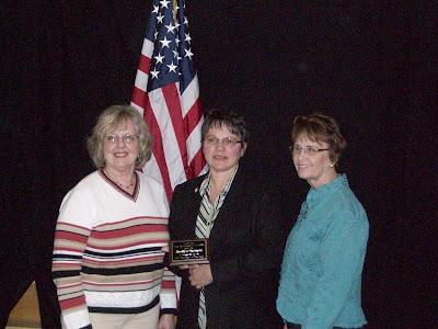 Tree Committee member Linda Varney, Mayor Sandra Johnson, Tree Committee Member Marde McConnell