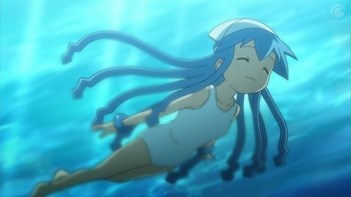 Squid Girl swims through the water happily, her tentacles fanning out around her